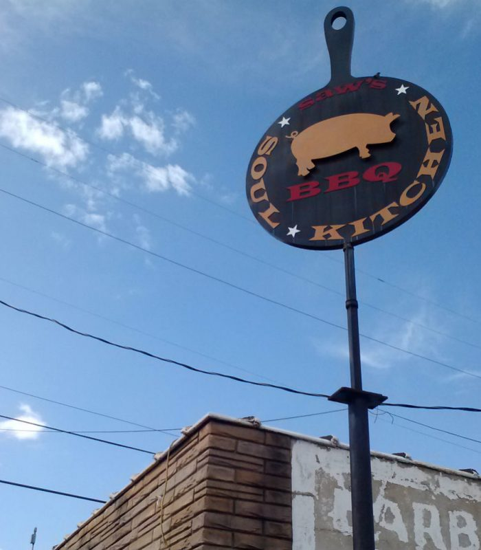 picture of the saw's soul kitchen sign above building exterior in the avondale neighborhood of birmingham